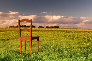The restless chair on the empty field at sunset