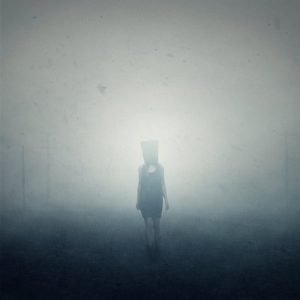 woman with bag in fog