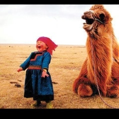exuberant girl and camel