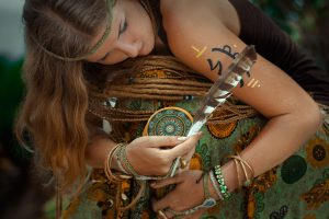 close up of young woman with tarot cards