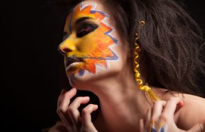 girl with color face art, perfect skin and hair. fashion